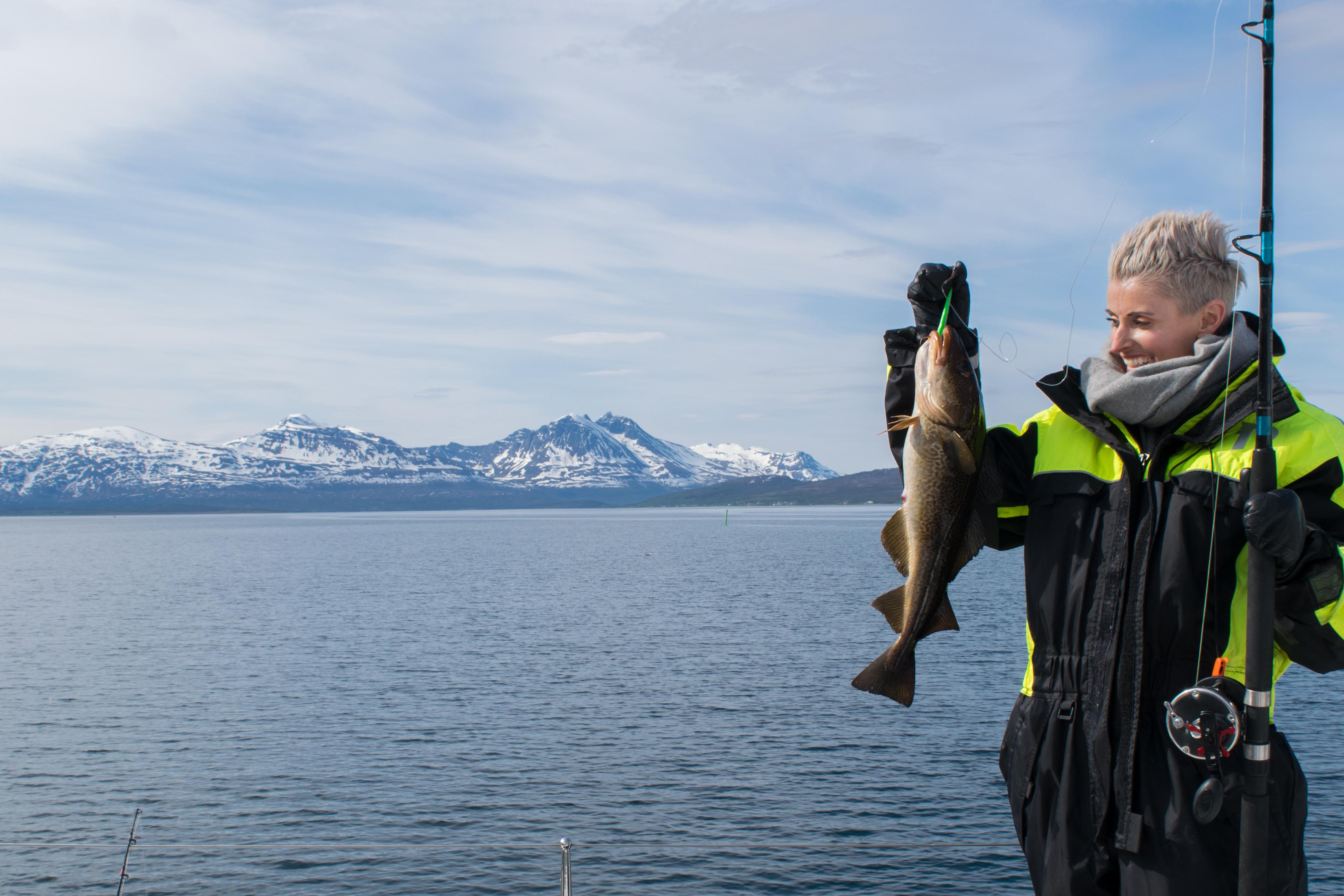 Beautiful girl fishing in northern Norway