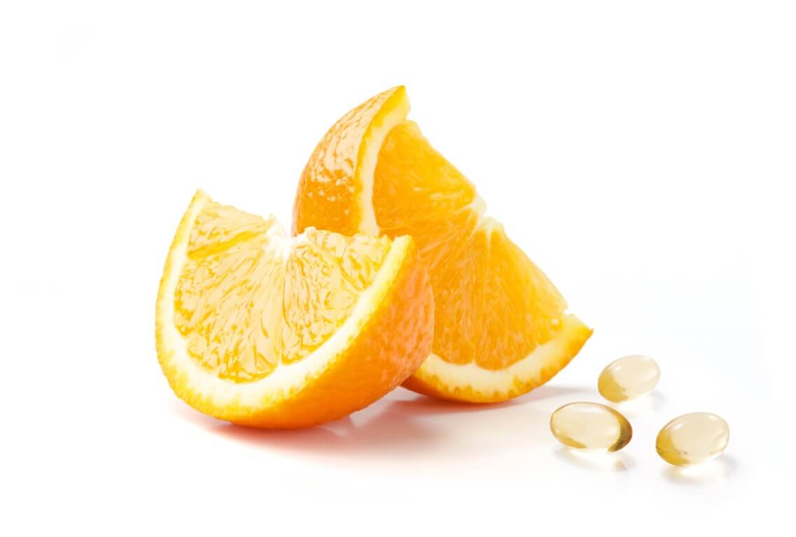 Image of omega-3 fish oil supplement pills and orange slices
